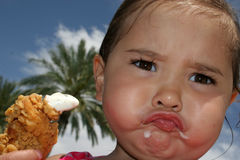 I Don't Like It !!. Young Child unsure of her lunch stock photos