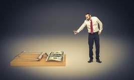 I don `t like cheating. Businessman refuses to take money from the mousetrap stock images