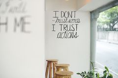 I don`t trust words, I trust actions. On wall Royalty Free Stock Photo
