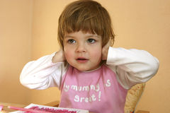 I don't wanna hear this, mummy!. Little, cheeky girl covering her ears with her hands Royalty Free Stock Images