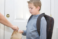 I don't want to go!. Young boy unhappy about going to school Stock Photography
