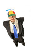 I don't want to grow up. Young boy in very large suit cap with blue propellor blade and saying I don't want to grow up missing his two front teeth isolated on Stock Photography