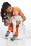 I dont like that. Mother is cuddling and feeding her young boy stock photos