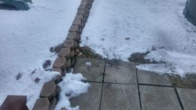 Sidewalk Snow. I dont like the snow on the sidewalk Royalty Free Stock Photography