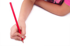 I draw! Child hand draws red pencil on blank backg Royalty Free Stock Image