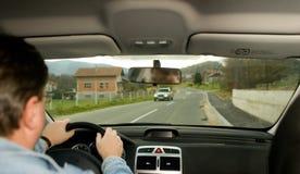 I drive my car. Sight inside of car rolling on a motorway thru village Stock Photo