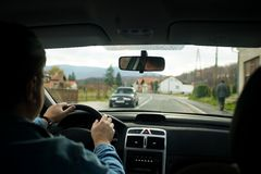 I drive my car. Sight inside of car rolling on a motorway thru village Royalty Free Stock Images