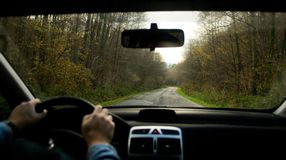 I drive my car. Sight inside of car rolling on a motorway Royalty Free Stock Photography