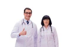 I due medici isolati sui precedenti bianchi Immagine Stock