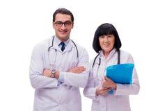 I due medici isolati sui precedenti bianchi Fotografie Stock