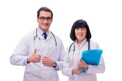 I due medici isolati sui precedenti bianchi Immagini Stock