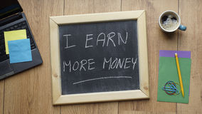 I earn more money Stock Images