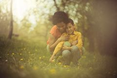 I enjoy with my mom on a spring day. Mother and son in the park stock image