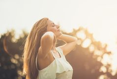 I feel beautiful. Young woman in nature. Close up. Copy space stock photography