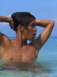 I feel pretty. Asian shirtless male portrait on the beach. Moalboal, Cebu, Philippines royalty free stock photo