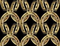 I ferri di cavallo modellano nei colori dorati e d'argento Fotografie Stock Libere da Diritti