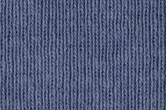 I fibcres blu sbiaditi del cotone si chiudono su fotografia stock libera da diritti