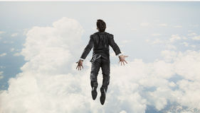 I finally did it . Mixed media. Happy businessman jumping high in sky to celebrate success Stock Photography