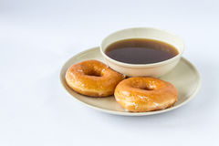 I find very good taste eat donut with ginger Stock Photo