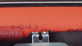 I find you - Typed on a old vintage typewriter. Printed on red paper. The red paper is inserted into the typewriter.  stock video
