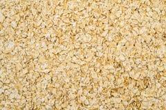 I fiocchi della farina d'avena si chiudono su come fondo Fotografia Stock