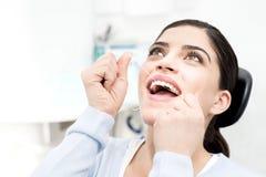 I am floss my teeth regularly. Royalty Free Stock Image