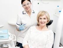 I am floss my teeth regularly. Stock Image