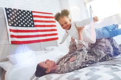 Happy cute girl playing with her mother royalty free stock photography
