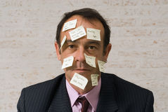 I Forgot Something. An isolated shot of a businessman with yellow sticky notes all over his face, which a has an expression that says, 'I forgot something Royalty Free Stock Photos