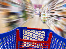 I found it. Trolley over a blurred background in a supermarket as a concept of fast shopping Stock Image