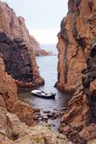 Mediterranean boat ocean rocks isolated rain alone rescue stock photography