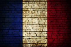 I francesi diminuiscono su un muro di mattoni immagini stock