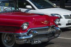 I am 56. Front detail of red 56 plate cadillac car with chrome bumpers Stock Image