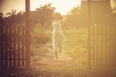 I am full of happiness and joy. Pregnant woman running to home. Copy space royalty free stock image