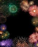 I fuochi d'artificio incorniciano con lo spazio della copia nel centro Immagini Stock