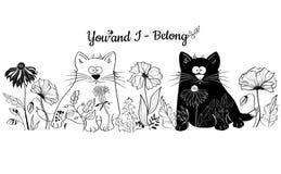 I gatti in bianco e nero si siedono in fiori Fotografia Stock Libera da Diritti