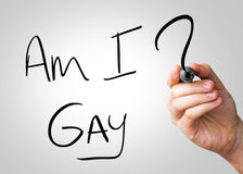Am I Gay hand writing with a black mark on a transparent board.  royalty free stock photo