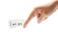 I am gay statement. Concept using a male hand and a piece of paper. The declaration is written with permanent marker Stock Image