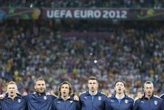 I giocatori della squadra di football americano dell'Italia cantano l'inno nazionale Fotografia Stock Libera da Diritti