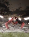 I giocatori di football americano nell'azione immagine stock libera da diritti