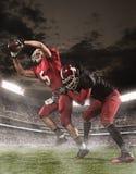 I giocatori di football americano nell'azione fotografia stock libera da diritti