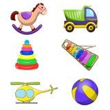 I giocattoli decorativi dei bambini messi del camion dell'elicottero della piramide dello xilofono dell'arcobaleno delle horse ba Fotografie Stock Libere da Diritti