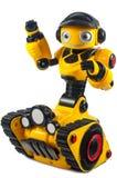 I giocattoli dei bambini - il robot giallo sul trattore a cingoli spinge Fotografia Stock