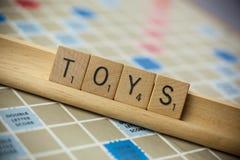 I giocattoli frugano le mattonelle immagini stock libere da diritti