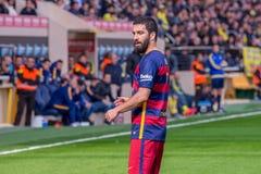 I giochi di Arda Turan alla La Liga abbinano fra il Villarreal CF ed il FC Barcelona Fotografia Stock Libera da Diritti