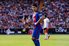 I giochi di Luis Suarez alla La Liga abbinano fra il Valencia CF ed il FC Barcelona a Mestalla Immagine Stock