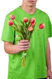 I giovani danno i fiori sopra backgroung bianco Immagine Stock Libera da Diritti