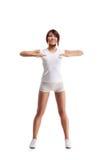 I giovani e un brunette di misura che allunga i suoi muscoli Immagini Stock