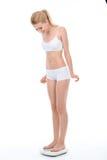 I giovani misura la ragazza bionda isolata su bianco Fotografia Stock Libera da Diritti
