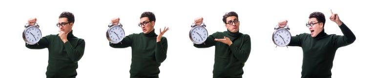 I giovani soldi del nerd con l'orologio gigante isolato su bianco immagini stock